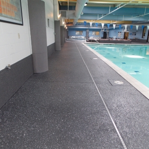 commercial pool deck with aggregate effects orange county