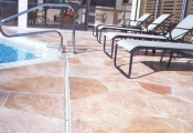 pool deck stamped concrete overlay