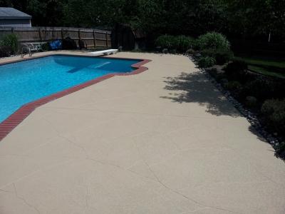concrete pool deck repair with custom scoreline pattern