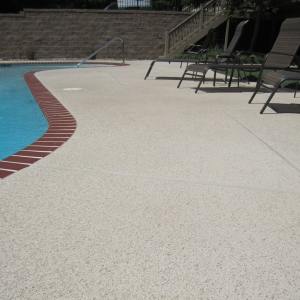 concrete pool deck with aggregate effects