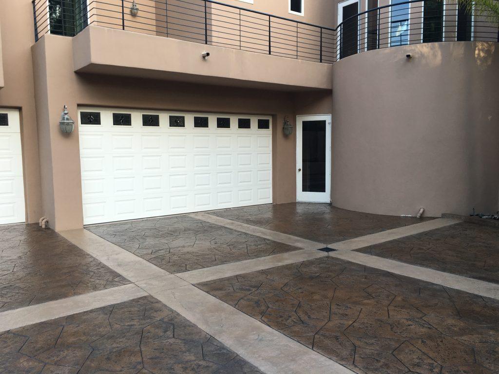 stamped-concrete-beside-white-garage-orange-county-ca